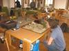 Lynx begutachtet den Malifaux-Tisch